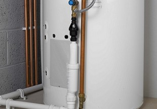 Discharge from unvented hot water storage cylinders into plastic sanitary pipework systems